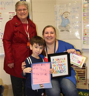 A teacher is honored by Elizabeth Hoeft of the U-46 Educational Foundation