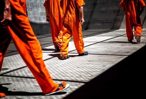 Inmates at the Twin Falls County Jail in Twin Falls, Idaho walk the year during their recreation time.