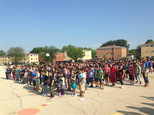 Parkwood elementary students standing for the pledge