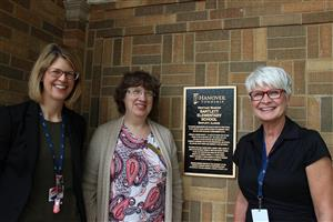 U-46 staff next to heritage marker at Bartlett elementary