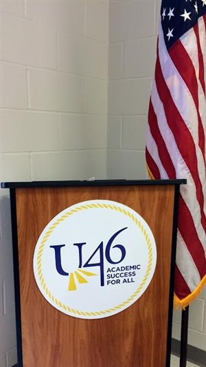 U-46 sign on podium with US flag