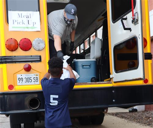 U-46 Student Gets Meal from a Bus