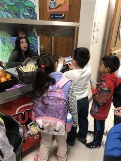 Students at a breakfast cart at Parkwood Elementary