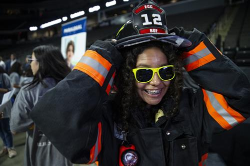 U-46 middle student tries on firefighter gear at Explore 2019